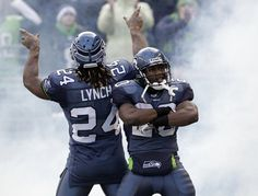 Seattle Seahawks Marshawn Lynch and Justin Forsett entertain the crowd as they are introduced before their NFL NFC wild card playoff football game against the New Orleans Saints, Saturday, Jan. 8, 2011, in Seattle