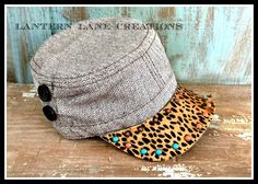 Hair on hide cadet cap with turquoise cabochos