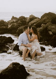 Beach Engagement Shoot in the Water by Rocks - Naples Florida Beach Engagement Photos — Michelle Gonzalez Photography - Country Engagement Pictures, Winter Engagement Photos, Engagement Photo Poses, Engagement Couple, Engagement Shoots, Engagement Photography, Fall Engagement, Indian Engagement, Wedding Photography