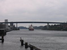 The Kiel Canal (German: Nord-Ostsee-Kanal, NOK), known as the Kaiser-Wilhelm-Kanal until is a mi) long canal in the German state of Schleswig-Holstein. Mi Long, Bridges, Denmark, Austria, Places Ive Been, Sailing, Cities, Germany, World