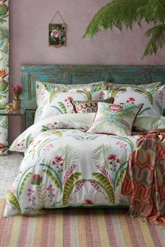 In need of some bedroom inspo for the summer season? Think palm prints and florals for your bedding!