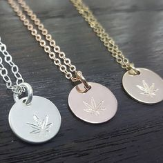 cannabis leaf hand stamped disc necklace in sterling silver