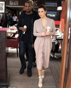 You're so sweet: Kim Kardashian and Kanye West leave a Cannes ice cream parlour with two cones