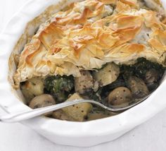 Mushroom, spinach & potato pie:  400g baby spinach 1 tbsp olive oil 500g mushrooms , such as chestnut, shiitake and button 2 garlic cloves , crushed 250ml vegetable stock (made from half a low sodium vegetable stock cube) 300g cooked new potatoes , cut into bite-sized pieces 1 tbsp grain mustard 1 tsp freshly grated nutmeg 2 heaped tbsp light crème fraîche 3 sheets filo pastry 300g each green beans and broccoli, steamed