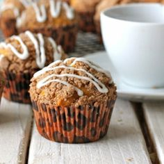 Start off fall with these pumpkin-bread muffins topped with a cinnamon streusel and a drizzled glaze. It's an autumn party in a muffin!