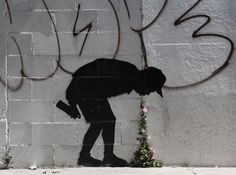Banksy; The combination of the silhouette and the real flowers that are growing in that place, creates a humorist piece, in which the kid is literally vomiting flowers. The vomit and the flowers are really two objects that do not relate with each other and seeing them together its a refreshing idea.