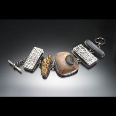 Nancy Blair one of my favorite jewelry designers. Love how she works with texture on silver and in addition how she puts stones within stones.