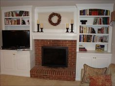 cabinets around fireplace- I think I would want my mantle replaced so that the pieces connected differently/ were more unfied