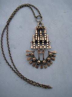 Famous owl  bronze necklace by Pentti Sarpaneva, Finland, 1970.