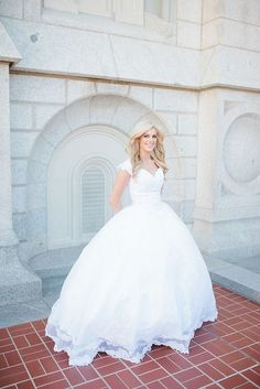 A beautiful modest wedding dress Love the pic in front of the temple. Kinda like the look of the ballgown.