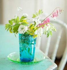 A pretty spring display is as easy as putting  blooms in a colorful tumbler. More easy spring decorating: http://www.midwestliving.com/homes/seasonal-decorating/50-bright-and-easy-spring-decorating-ideas/?page=31