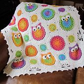 Crocheted baby blanket. Maybe make the owls brown, and the dots purple or blue or green or something.
