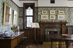 "Wightwick Manor: The Morning Room at Wightwick Manor, Wolverhampton, West Midlands. The wallpaper is ""Leicester"" designed by John Dearle for Morris & Co and printed by Sanderson. The fireplace has De Morgan ""Rose"" pattern tiles."