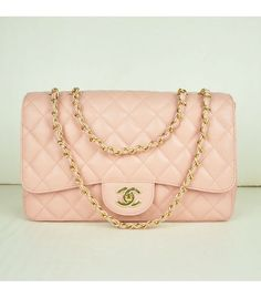This pink Chanel jumbo flap bag is my dream. I love the delicate, feminine color of the light pink accented with a gold chain and gold C's. This very popular style comes in many colors and editions, but if I could have just one, I would choose this pink. It's different than the classic black, but it still invokes that feeling of luxe and glamour Chanel is known for. :) In love?? I am!