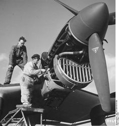 German mechanics working on the engine of a Ju 87 Stuka dive bomber, 1944 Source	   	German Federal Archive