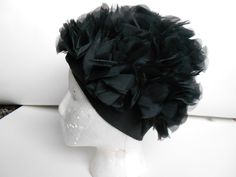 Vintage 1960s Black Fluffy Petal Hat by Playgirl of Los Angeles. $37.50, via Etsy.