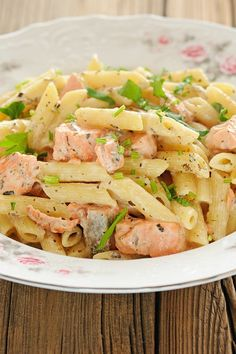Recipe including course(s): Entrée; and ingredients: black pepper, butter, canned mushrooms, flour, garlic, onion, penne pasta, romano cheese, salmon, salt, skim milk