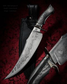 "Kyle Gahagan, JS ~ Persian Bowie knife. 12 1/2"" 1075 carbon steel blade, blue steel guard with titanium spacer. Carbon fiber handle. Sheath is by Lance Parrish. That is a beautiful Persian-style Bowie. I love that graceful swedge and busy hamon. Very cool blade all around."