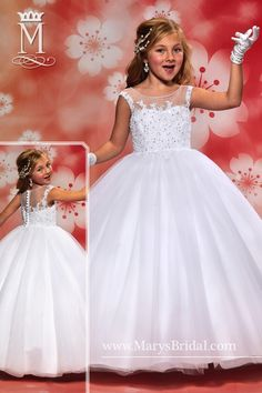 Flower girl tulle ball gown with bead edged bateau neckline, re-embroidered lace on bodice, and zipper back with wrapped buttons. Available in White and Ivory.