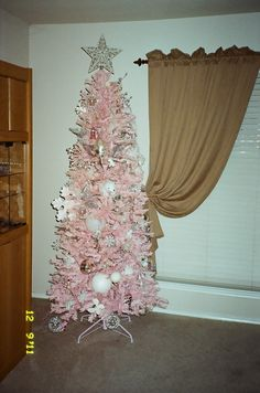 Pretty in pink Christmas tree!!! Bebe'!!! Adore this pretty feminine shade of medium pink and the slender but full shape of the tree!!!!