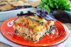 Баклажаны, запеченные с фаршем и томатами под сырной корочкой
