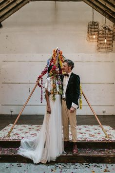 pyramid wedding backdrop with floral garlands