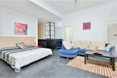King-sized bed and sofa bed with a coffee table in one of the biggest rooms in this villa.