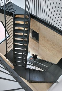 An angular black staircase criss-crosses between split levels inside this wooden prefab house in Amsterdam designed by Marc Koehler Architects. Black Staircase, Staircase Design, Prefabricated Houses, Prefab Homes, Amsterdam Houses, Amsterdam Netherlands, Casa Loft, Balustrades, Industrial Stairs