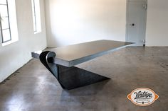 It's shown with a cold rolled steeltop 96″ x 40″ in size. The base is made from heavy plate steel. The top is also available in polished stainless. The base is available in various colors and finishes. Please note that all wooden tops manufactured by Vintage Industrial include a 3 - 6 breadboard on both ends of the table to prevent warping of hardwoods.