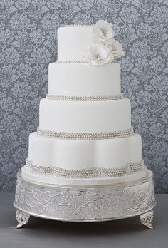 White Wedding Cakes Cakes | Brides.com- this is beautiful minus that cake stand though, that's just gaudy...