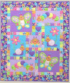 The Bugsy Applique and Pieced Quilt Pattern by Kids Quilts features  friendly bugs and flowers, including butterflies, snails, and caterpillars.  What a wonderful, fun crib or lap sized children's quilt!  Create fun and happy quilts using colorful, bright, and whimsical fabrics.  This quilt is assembled using traditional piecing and fusible applique. The  pattern is designed with fusible applique, so I recommend that you use an  Applique Pressing Sheet.  This company put a lot of thought…