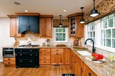 Oak cabinets with updated knobs and fixtures