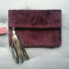 Velvet clutch Dark purple velvet clutch from Target. New with tags. Inside pocket and cute tassel (shown) Merona Bags Clutches & Wristlets