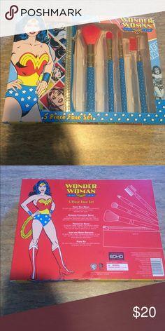 NEW Wonder Woman Makeup Brushes Brand new set of 4 Wonder Woman makeup brushes and makeup bag to carry them. Makeup Brushes & Tools