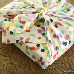 What a clever idea -- furoshiki cloth is a type of large handkerchief used as gift wrap. Love it! And how cute are those polka dots?