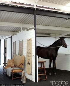 Happy horses: The sprawling ranch includes several large barns for the horses that have a homey feel | Elle Decor