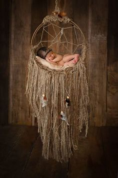 This beautiful, rustic dream catcher is made of a wood base and a ...