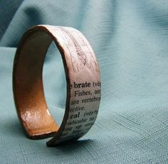 Elizabeth Abernathy: Recycled Cardboard Tube Bracelets. Particularly like this one with the dictionary picture & definition