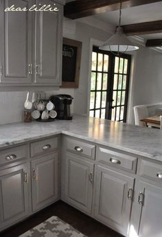 Darker Gray Cabinets with Marble  Cabinet Color- Winter's Gate in Semi-Gloss by Benjamin Moore Wall Color- Horizon in Eggshell by Benjamin Moore Trim Color - Simply White in Semi-Gloss by Benjamin Moore