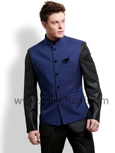 Imported fabric is designed in most popular black color #Jodhpuri Suit with attractive blue waist coat. Item Code ; TSJL1109 http://www.lalitkhatri.com/label/men/mens-designer-suits.html