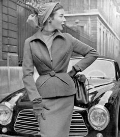 Bettina in suit with fitted jacket fastened by single button worn over jersey blouse by Schiaparelli, photo by Pottier, 1951