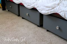 Under-The-Bed Storage : Thrifted drawers, painted and knobbed with casters