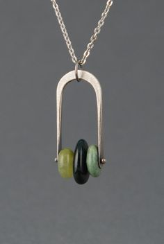Simple, and could make several with different stones and metals. -Three Pebbles