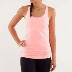Lululemon pink crb tank Peachy pink cool Racerback tank, luon fabric. Great condition with very minor wash wear. bundles lululemon athletica Tops Tank Tops