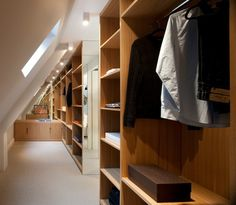 Contemporary Wardrobe by TG-Studio. Great use of space under the eaves.