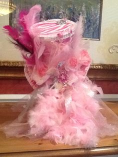 Alice In Wonderland themed bridal shower - This hat was created and used as a centerpiece - This is Kalley's hat - The Flower Girl