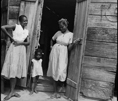 Three generations that the door in beautiful Haiti 1958. | Photograph by Denise Colomb for the Ministry of Culture in France.