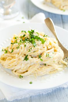Roasted Cauliflower Fettuccine Alfredo - this is a much healthier and lighter alternative to traditional full fat fettuccine. It uses roasted cauliflower in place of the cream and I actually like it BETTER than regular alfredo. It's so creamy and delicious!! Maybe replace noodles w spaghetti squash