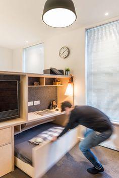 CIAO adds space-saving custom furniture to London micro apartment