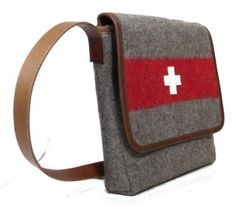 Swiss army blankets have become a sought after material by craftsmen and women who turn them into beautiful bags and accessories. Messenger Bag Medium With adjustable leather strap, inner pocket and velcro closing. Materials: Swiss woolen army blankets (made before 1980),